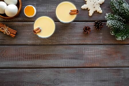 Make festive drink eggnog - ingredients on dark wooden background top view frame copy space Stok Fotoğraf