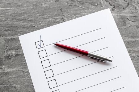 Empty check list ready to fill on grey background top view