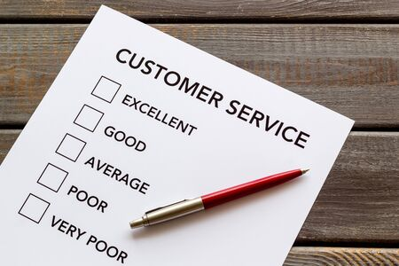 Customer service form with mark Exellent close up on dark wooden background top view
