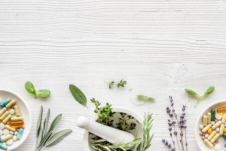 Apothecary of natural wellness and self-care. Herbs and medicine on white wooden background top view frame copy space Stock Photo