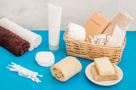 Bathroom cosmetics and hygiene products on blue background