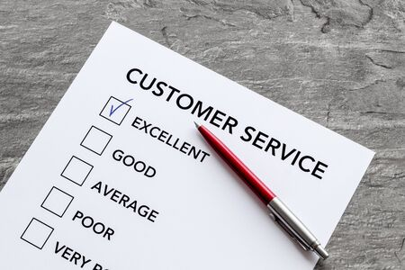 Customer service form with mark Exellent close up on grey background top view