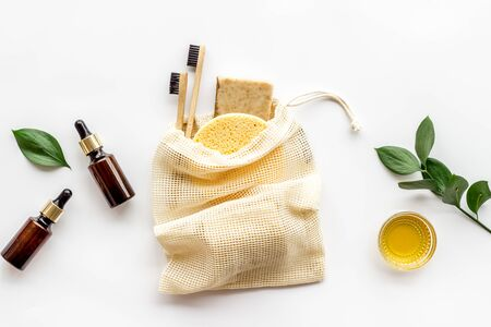 Self-care with herbal formulations - essential oils and soap - on white background top view copy space