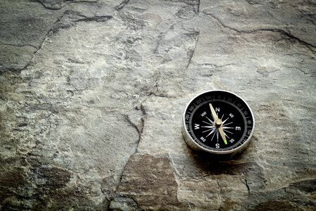 Compass - small and stylish - on grey background copy space