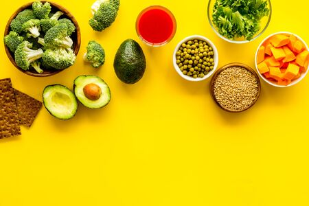 Healthy food. Vegatables and fruits on yellow background top view frame copy space