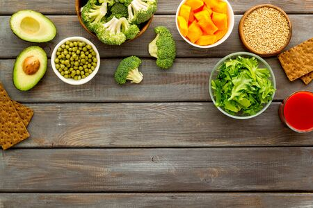 Diet program concept. Set of fresh vegatables and fruits on dark wooden background top view frame copy space Stock fotó