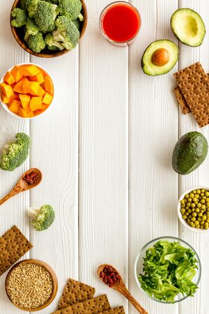 Healthy food. Vegatables and fruits on white wooden background top view.