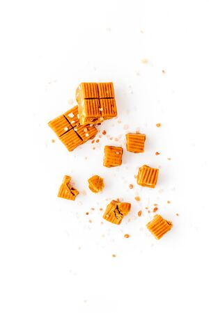 Salted caramel pieces paradoxical sweets on white