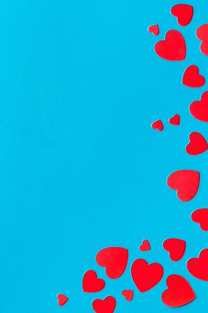 Valentines Day design. Red hearts frame on blue background top-down copy space