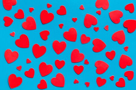 Red hearts pattern - Valentines Day concept - on blue background top-down 写真素材
