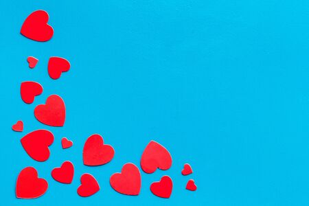 Valentines Day design. Red hearts frame on blue background top-down. 写真素材