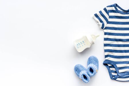 Baby background. Clothes and accessories for newborn boy on white table top-down. Reklamní fotografie