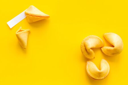 Traditional fortune cookies on yellow table top-down. Stock Photo