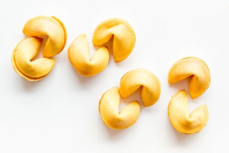Traditional fortune cookies on white table top-down
