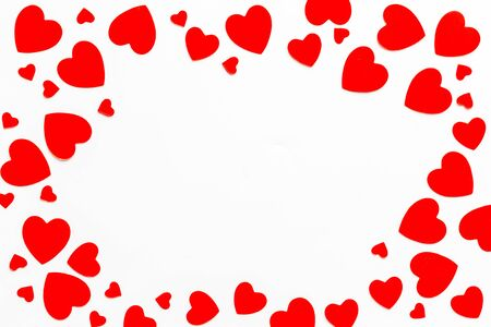 Valentines Day design. Red hearts frame on white background top-down.