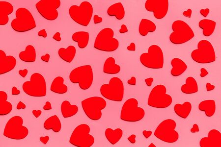 Red hearts pattern - Valentines Day concept - on pink background top-down