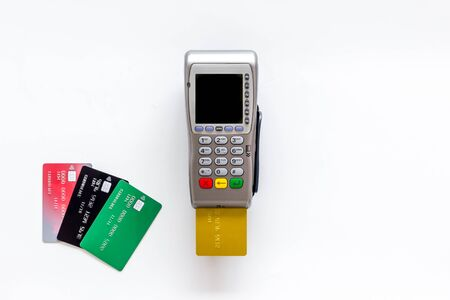 Pay by credit card in shop. Terminal and card on white background top-down copy space Stock Photo