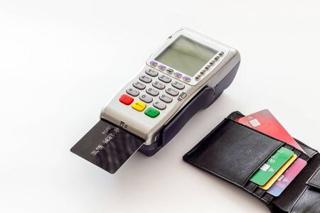 Bank terminal for payments and plastic card on white background