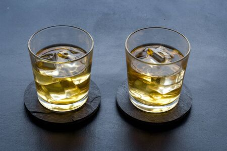 Scotch - two glasses with ice - on black background. Reklamní fotografie