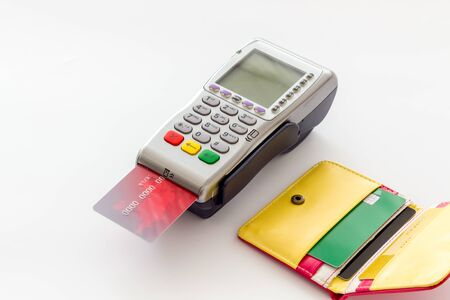Bank terminal for payments and plastic card on white background.