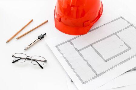 Builder helmet and blueprints on white background. 写真素材