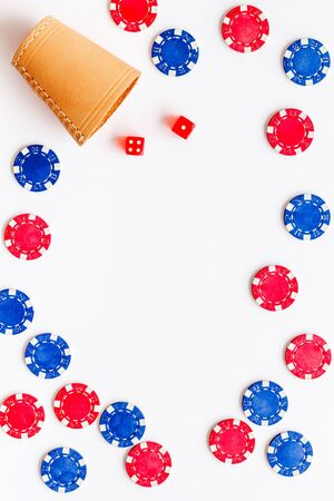 Poker frame. Chips and dices on white background top-down copy space