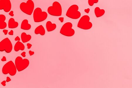 Valentines Day design. Red hearts frame on pink background top-down copy space