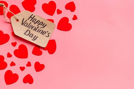Happy Valentines Day design. Red hearts frame with lable on pink background top-down copy space
