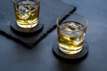 Scotch - two glasses with ice - on black background. 스톡 콘텐츠