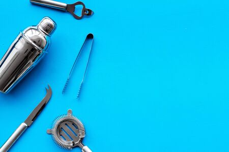 Bar utensil, tools - shaker, stainer - on blue background top-down frame. 스톡 콘텐츠
