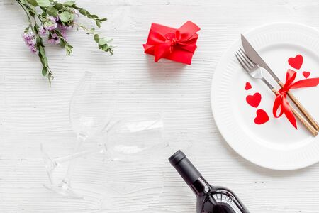 Valentines day table. Plate on white background top-down