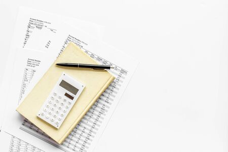 Financial literature. Books near documents, calculator on white background top-down copy space