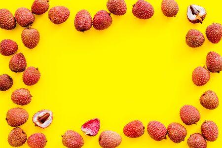 Lychee frame. Fresh juicy fruits on yellow background top-down copy space 版權商用圖片