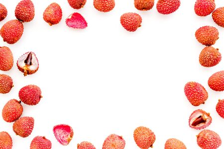 Lychee frame. Fresh juicy fruits on white background top-down copy space
