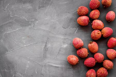 Lychee frame. Exotic asian fruits on grey background top-down copy space 版權商用圖片