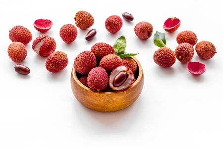 Ripe lychee. Exotic asian fruits in bowl on white desk