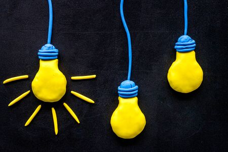 Creativity concept. Bulb icons on black background top-down
