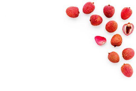 Lychee frame. Fresh juicy fruits on white background top-down. 版權商用圖片