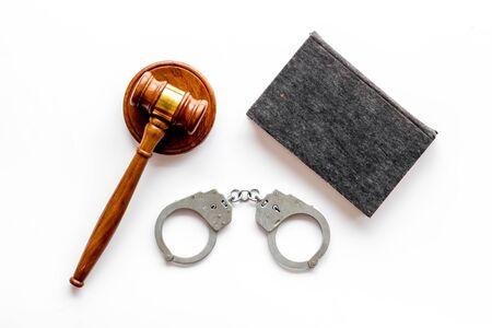 Arrest concept. Handcuffs near judge gavel on white background top-down