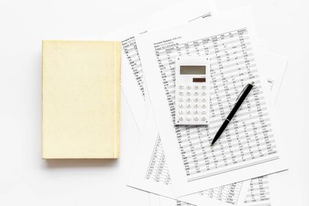 Financial literature. Books near documents, calculator on white background top-down. Stock Photo