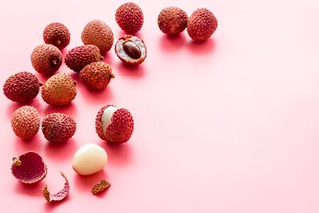 Lychee frame. Exotic asian fruits on pink background copy space