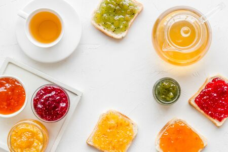 Tea party with jam. Toast, teapot, cup on white background. 版權商用圖片