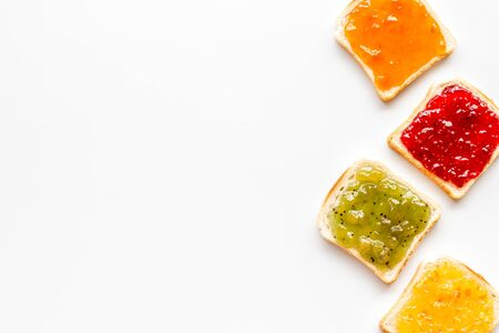 Toast with jam. Colorful set on white background top-down. 版權商用圖片