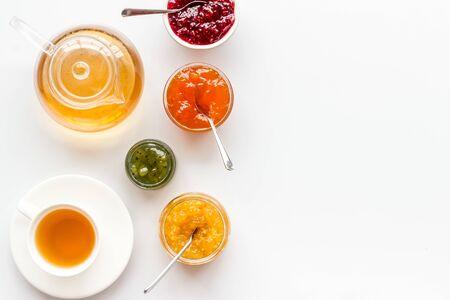 Fruit jam near tea on white kitchen desk. 版權商用圖片