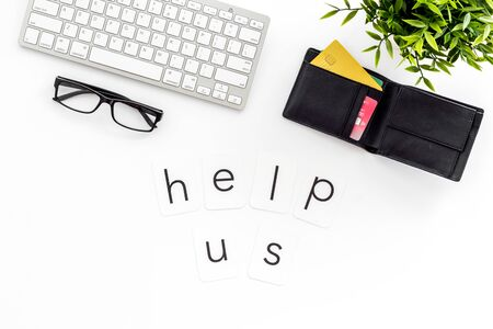Help us text. Donation online concept with bank card and keyboard on white background top-down.