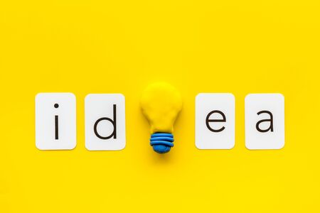 Idea concept. Bulb icon on yellow background top-down.