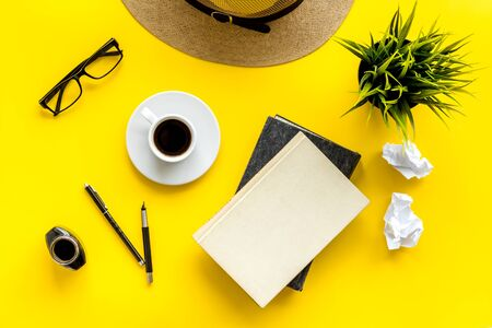 Writers block concept. Notebook, pen, crumpled paper on yellow background top-down. Banco de Imagens