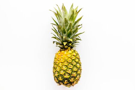 Pineapple whole fruit on white background top-down copy space