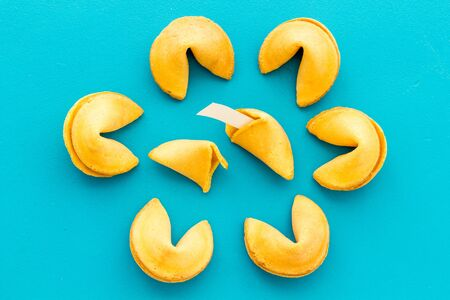 Fortune cookie background on blue table top-down pattern Archivio Fotografico