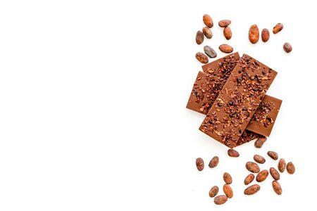 Chocolate - stack of dark bars - on white background top-down. 版權商用圖片